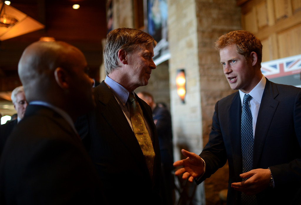 . SEDALIA, CO. - MAY 10 : From left, Denver Mayor Michael Hankock, Colorado Gov. John Hickenlooper and Prince Harry are talking during the reception at Club House of Sanctuary Golf Course in Sedalia, Colorado. May 10, 2013. (Photo By Hyoung Chang/The Denver Post)