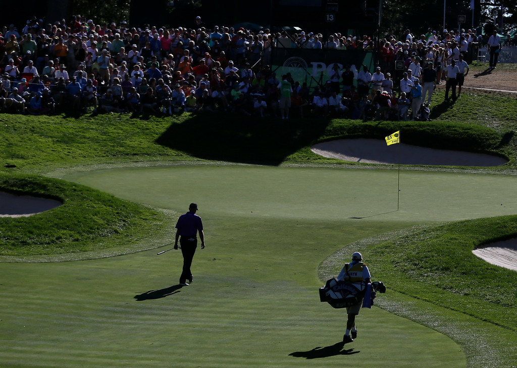 . Jim Furyk walks to the 13th green during the third round of the PGA Championship golf tournament at Oak Hill Country Club, Saturday, Aug. 10, 2013, in Pittsford, N.Y. (AP Photo/Julio Cortez)