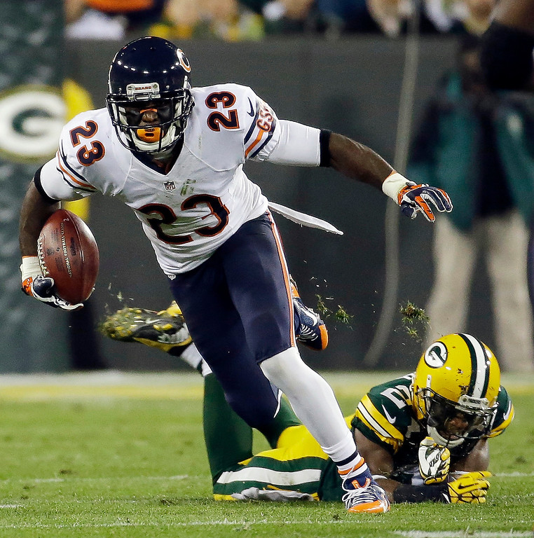 . Chicago Bears\' Devin Hester tries to get past Green Bay Packers\' Jarrett Bush on a punt return during the second half of an NFL football game Monday, Nov. 4, 2013, in Green Bay, Wis. (AP Photo/Morry Gash)
