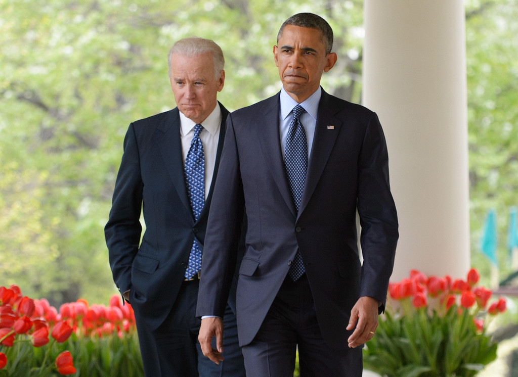 . US President Barack Obama and Vice President Joe Biden walk through the Colonnade to deliver remarks on gun control on April 17, 2013 in the Rose Garden of the White House in Washington, DC.  MANDEL NGAN/AFP/Getty Images