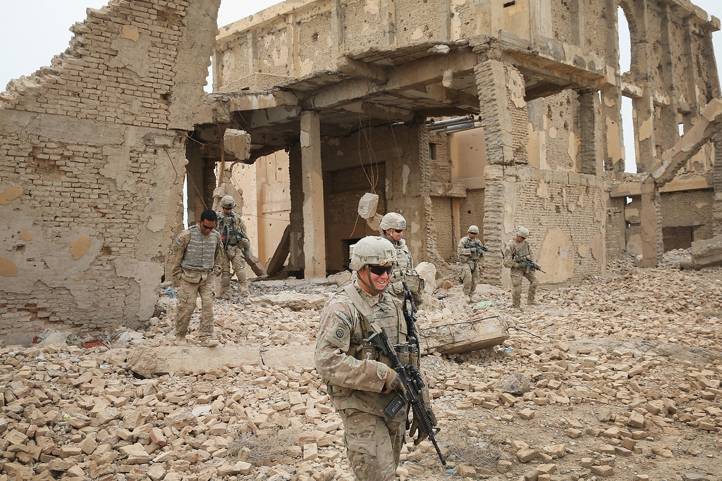 . Soldiers from the U.S. Army\'s 4th squadron 2d Cavalry Regiment meet with visit an Afghan National Police (ANP) outpost that was once home to Osama Bin Laden during a patrol on February 25, 2014 near Kandahar, Afghanistan.    (Photo by Scott Olson/Getty Images)