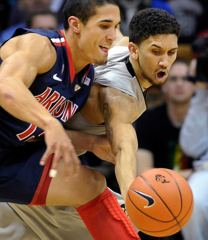 . BOULDER, CO. - FEBRUARY 14: Colorado point guard Askia Booker (0) stole the ball from Wildcats guard Nick Johnson (13) in the first half. The University of Colorado men\'s basketball team hosted Arizona Thursday night, February 14, 2013 at the Coors Event Center in Boulder. (Photo By Karl Gehring/The Denver Post)