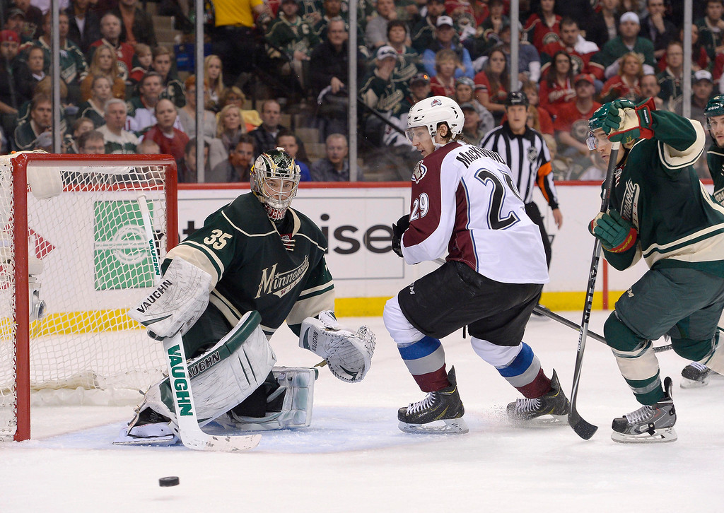 . Colorado Avalanche center Nathan MacKinnon (29) watches his deflection goes by Minnesota Wild goalie Darcy Kuemper (35) during the second period April 21, 2014 during round 1 game three of the Stanley Cup Playoffs at Xcel Energy Center. (Photo by John Leyba/The Denver Post)