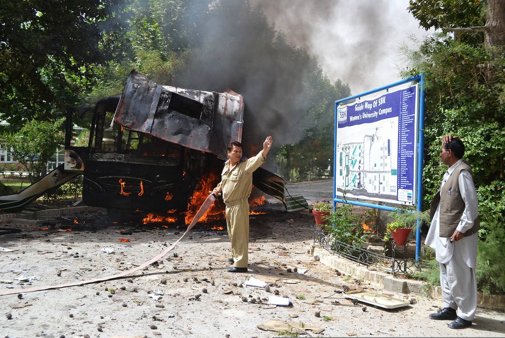 . Pakistani fire fighters extinguish a burning university bus after the bomb blast in Quetta, the capital of Baluchistan province, on June 15, 2013.   AFP PHOTO/ Banaras  KHAN/AFP/Getty Images