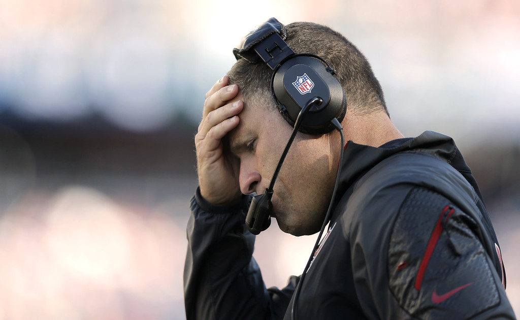 . Head coach Greg Schiano holds his head during the fourth quarter of their 23-3 loss to the New England Patriots at Gillette Stadium on September 22, 2013 in Foxboro, Massachusetts.  (Photo by Winslow Townson/Getty Images)