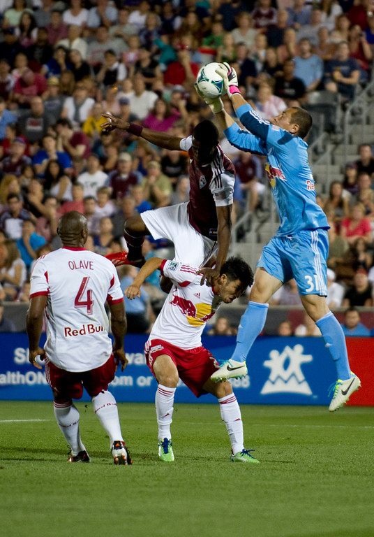 . DENVER - JULY 4: New York Red Bulls goalie #31 Luis Robles makes a catch over #26 of the Colorado Rapids Deshorn Brown during the second half of a MLS soccer match against the New York Red Bulls on July 4, 2013 at Dick\'s Sporting Goods Park. The Rapids defeated the Red Bulls 2-0. (Photo By Grant Hindsley / The Denver Post)