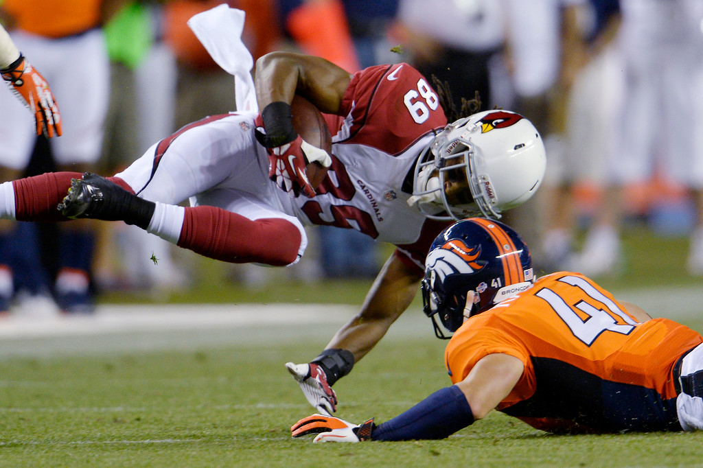 . Ross Rasner (41) of the Denver Broncos shoestring tackles Charles Hawkins (89) of the Arizona Cardinals during the last pre-season game of the season at Sports Authority Field at Mile High. August 29, 2013 Denver, Colorado. (Photo By Joe Amon/The Denver Post)