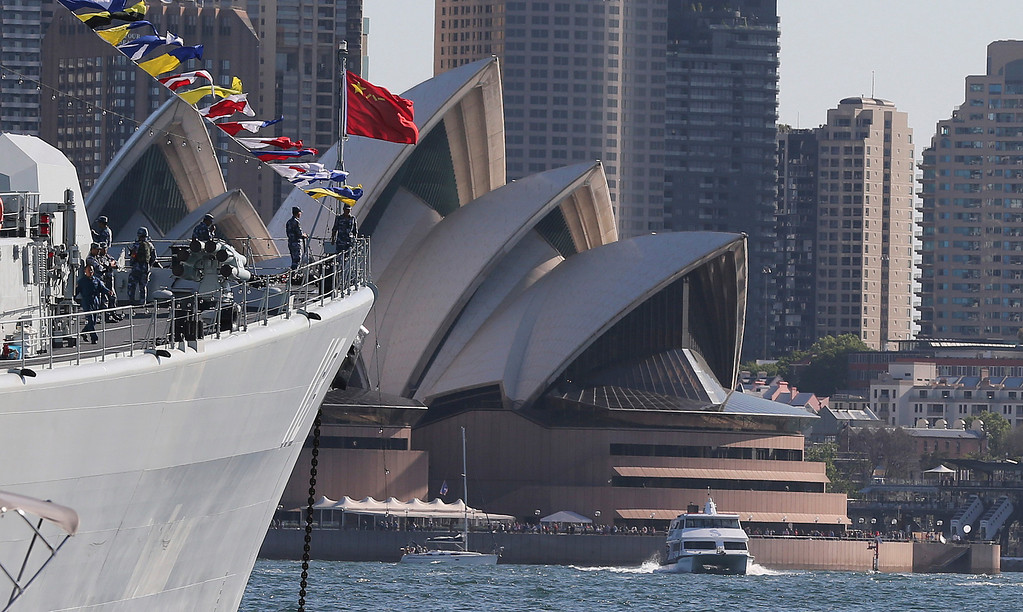 . Chinese warships Plan Qingdao anchors in Sydney Harbor with the Opera House in the background during the International Fleet review in Sydney, Australia, Friday, Oct. 4, 2013. The warship will join about 40 others in the Fleet Review to commemorate the centenary of the first entry of the Royal Australian Navy fleet into Sydney Harbor on October 4, 1913.(AP Photo/Rob Griffith)