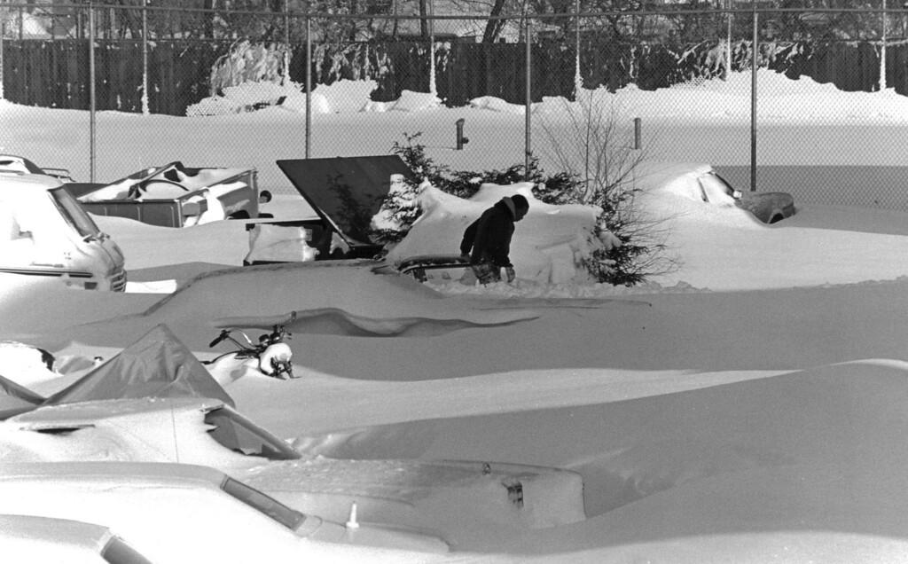 . A parking lot with cars buried in up to three feet of snow after the Blizzard of \'82. Denver Post Library Archive