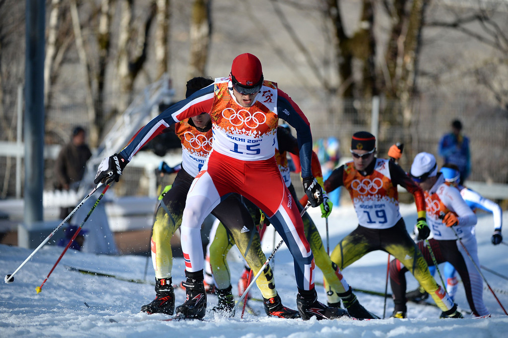 . Norway\'s Magnus Hovdal Moan (15)  leads the pack as they compete in the Nordic Combined Individual NH / 10 km Cross-Country at the RusSki Gorki Jumping Center during the Sochi Winter Olympics on February 12, 2014 in Rosa Khutor near Sochi.   AFP PHOTO / PETER PARKS/AFP/Getty Images