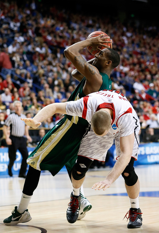 . LEXINGTON, KY - MARCH 23: Greg Smith #44 of the Colorado State Rams gets fouled by Stephan Van Treese #44 of the Louisville Cardinals in the second half during the third round of the 2013 NCAA Men\'s Basketball Tournament at Rupp Arena on March 23, 2013 in Lexington, Kentucky.  (Photo by Kevin C. Cox/Getty Images)