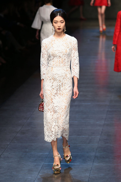 . A model walks the runway at the Dolce & Gabbana fashion show as part of Milan Fashion Week Womenswear Fall/Winter 2013/14 on February 24, 2014 in Milan, Italy.  (Photo by Vittorio Zunino Celotto/Getty Images)