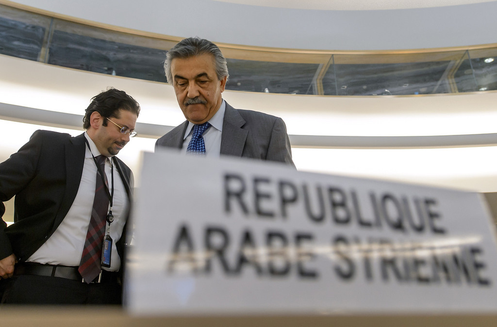 . The permanent representative of the Syrian Arab Republic at the United Nations (UN) Human Rights Council, Faysal Khabbaz Hamoui (C), arrives on May 29, 2013 for an urgent debate on Syria in Geneva. The council is to consider a resolution condemning the Syrian regime\'s use of foreign fighters in Qusayr. FABRICE COFFRINI/AFP/Getty Images