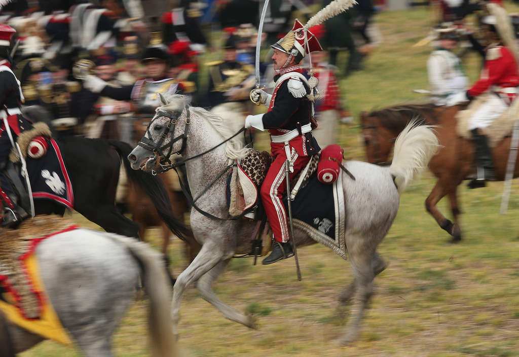. Historical society enthusiasts in the role of Polish lancers loyal to Napoleon retreat during the re-enactment of The Battle of Nations on its 200th anniversary on October 20, 2013 near Leipzig, Germany. (Photo by Sean Gallup/Getty Images)