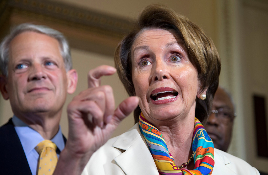 . House Minority Leader Nancy Pelosi of Calif., accompanied by Rep. Steve Israel, D-N.Y., left, and House Assistant Minority Leader James Clyburn of S.C., gestures while speaking during a news conference on Capitol Hill, in Washington, Monday, Sept. 30, 2013.  (AP Photo/Manuel Balce Ceneta)