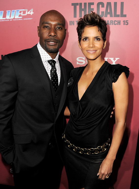 """. Actors Morris Chestnut (L) and Halle Berry arrive at the premiere of Tri Star Pictures\' \""""The Call\"""" at the Arclight Theatre on March 5, 2013 in Los Angeles, California.  (Photo by Kevin Winter/Getty Images)"""