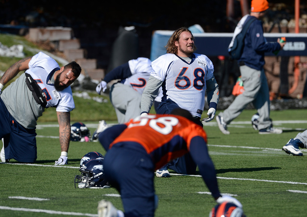 . Denver Broncos guard, Zane Beadles, #68, stretches along with his teammates during practice Friday morning, October 18, 2103. (Photo By Andy Cross/The Denver Post)