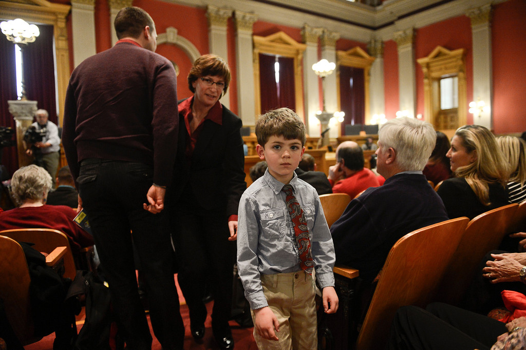 . Denver, CO. - January 23: Five year old Jeremy Simon leaves the court room with one of his moms Fran after the family gave testimony to the Senate Judiciary Committee on Senate Bill 11 at the Denver State Capitol. The bill would allow gay couples to form civil unions.   Denver, Colorado January 23, 2013. (Photo By Joe Amon / The Denver Post)