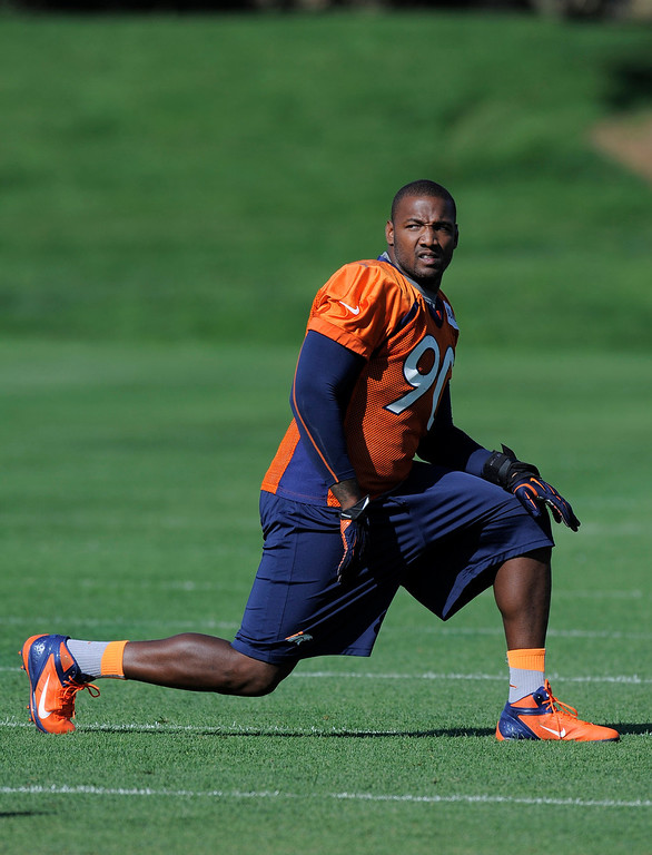 . Denver Broncos outside linebacker Shaun Phillips (90) stretches before practice September 9, 2013 at Dove Valley. (Photo by John Leyba/The Denver Post)