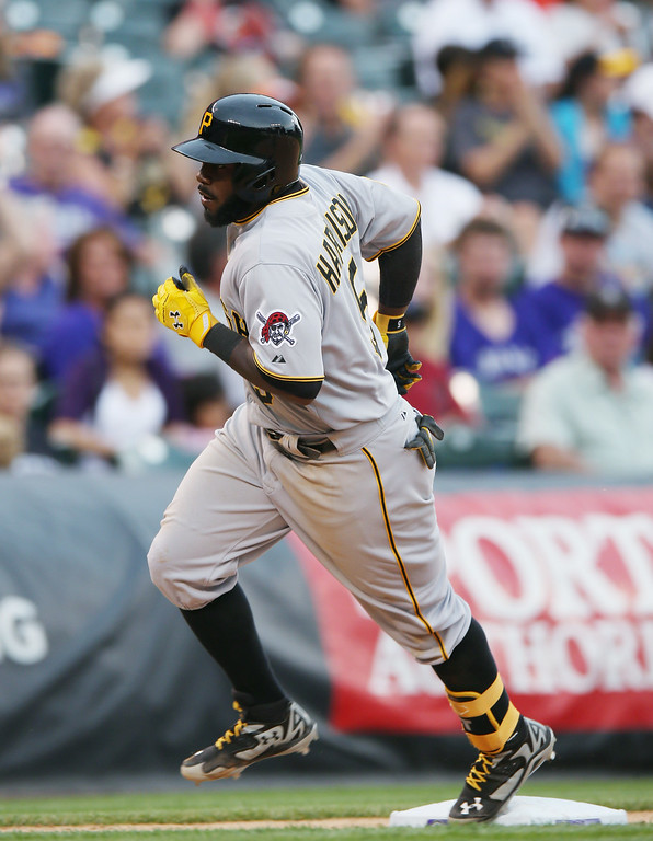 . Pittsburgh Pirates\' Josh Harrison circles the bases after hitting a solo home run against the Colorado Rockies to lead off the eighth inning of the Pirates\' 7-5 victory in a baseball game in Denver on Sunday, July 27, 2014. (AP Photo/David Zalubowski)