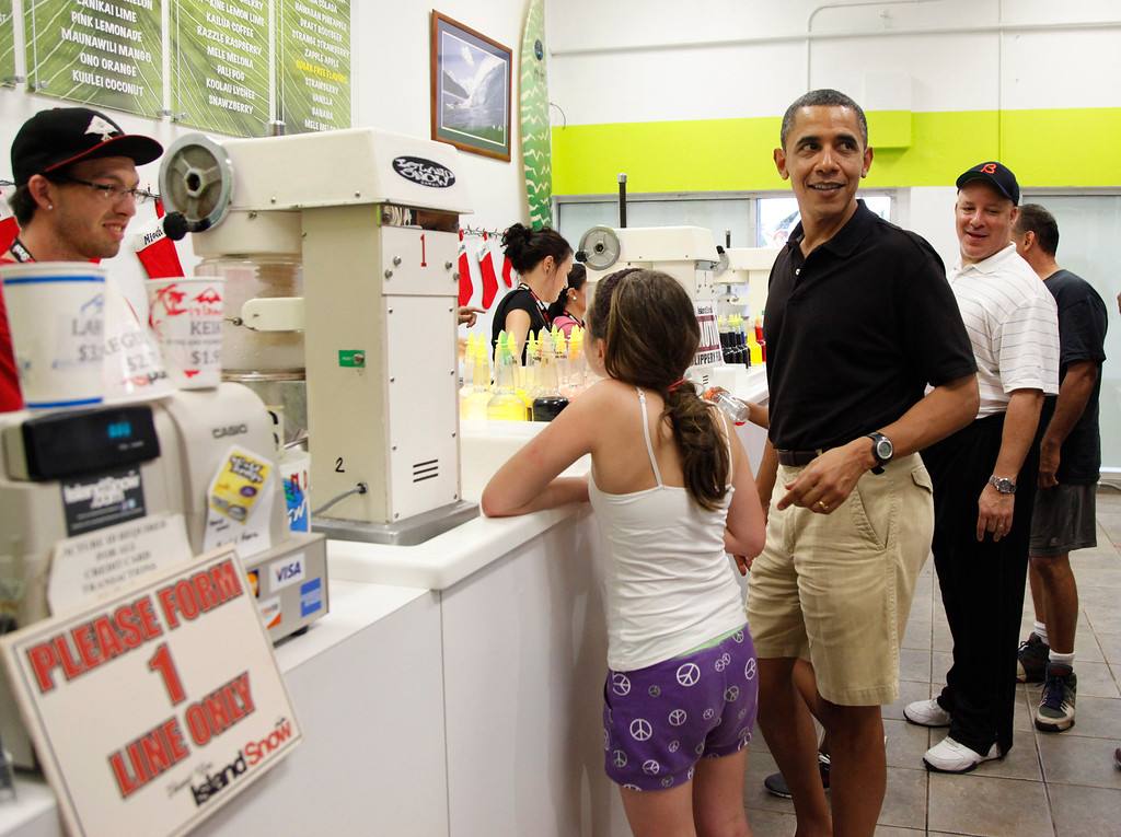 . President Barack Obama orders Shave Ice with family and friends at Island Snow at Kailua Beach Center while on vacation with the first family in Kailua, Hawaii, Monday, Dec. 27, 2010. (AP Photo/Carolyn Kaster)