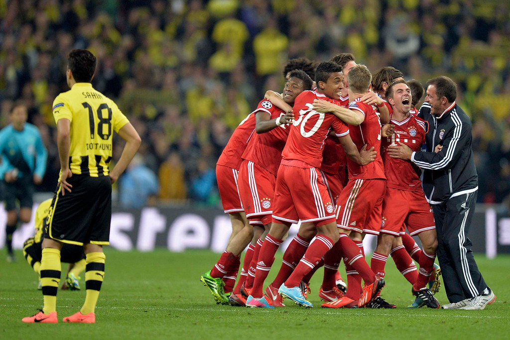 . Bayern Munich players react, after winning the Champions League Final soccer match against Borussia Dortmund, at Wembley Stadium in London, Saturday May 25, 2013.  (AP Photo/Martin Meissner)