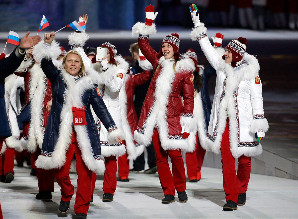 . Russian athletes wave to spectators as they arrive during the opening ceremony of the 2014 Winter Olympics in Sochi, Russia, Friday, Feb. 7, 2014. (AP Photo/Mark Humphrey)