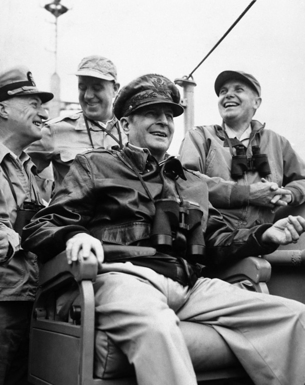 . Gen. Douglas MacArthur, commander-in-chief of United Nations Forces, on the bridge of the USS McKinley on his arrival at Inchon Harbor in September, 1950. Standing left to right are: Vice Admiral Arthur D. Strubble, Commander of the U.S. Seventh Fleet; Brig. Gen. E.K. Wright, Assistant Chief of Staff, G-3 Far East command and Major Gen. Edward M. Almond, Commanding General, 10th corps. (AP Photo)