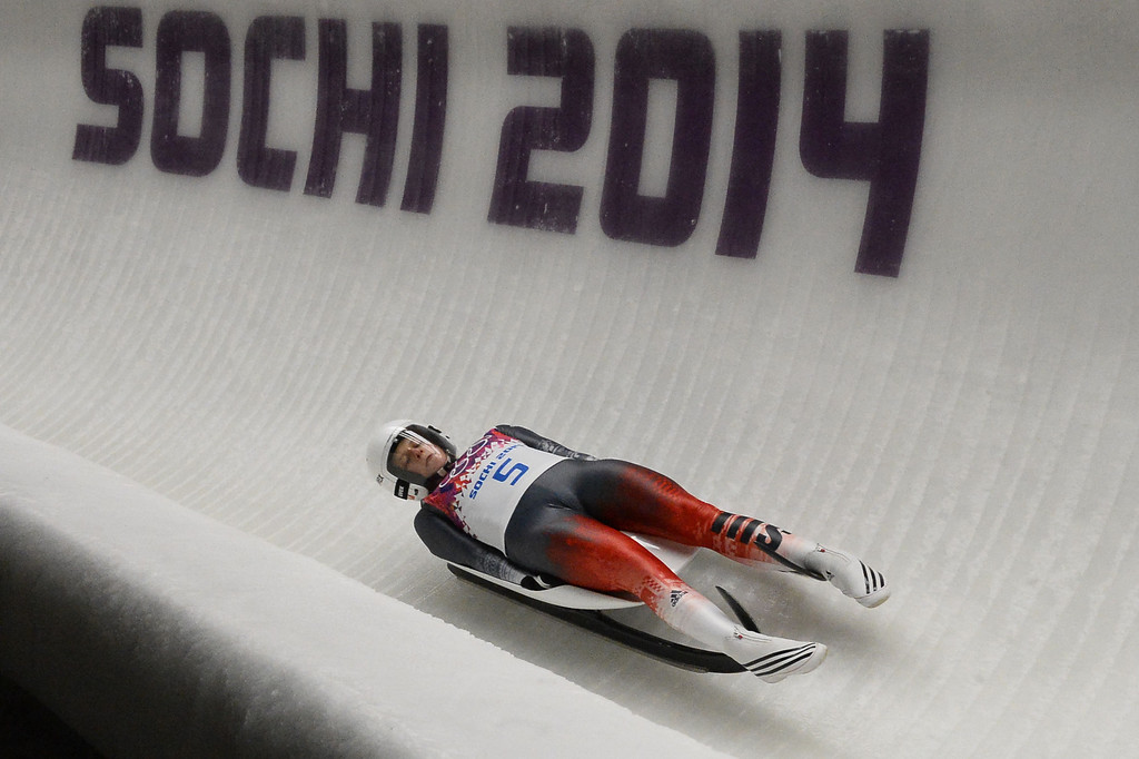 . Switzerland\'s Martina Kocher competes during the Women\'s Luge Singles run two at the Sliding Center Sanki during the Sochi Winter Olympics on February 10, 2014.   AFP PHOTO / LIONEL BONAVENTURE/AFP/Getty Images