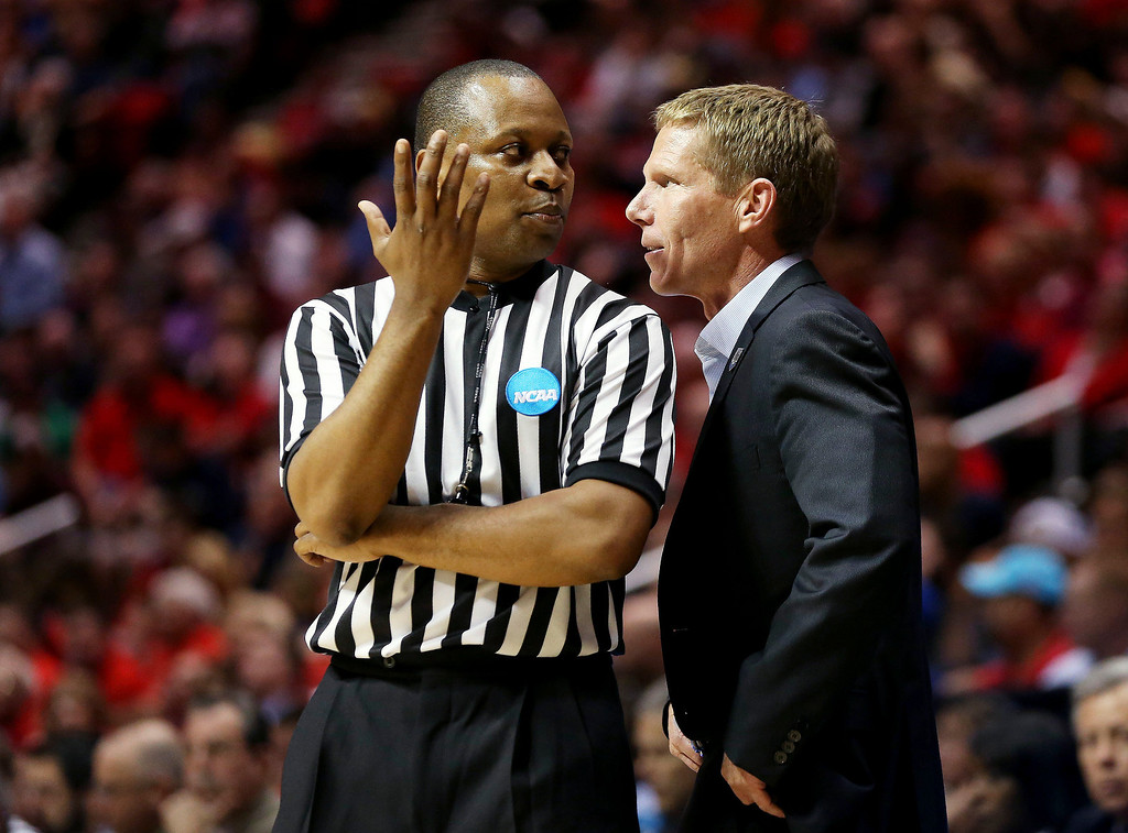 . Head coach Mark Few of the Gonzaga Bulldogs speaks to a referee in the first half against the Arizona Wildcats during the third round of the 2014 NCAA Men\'s Basketball Tournament at Viejas Arena on March 23, 2014 in San Diego, California.  (Photo by Jeff Gross/Getty Images)