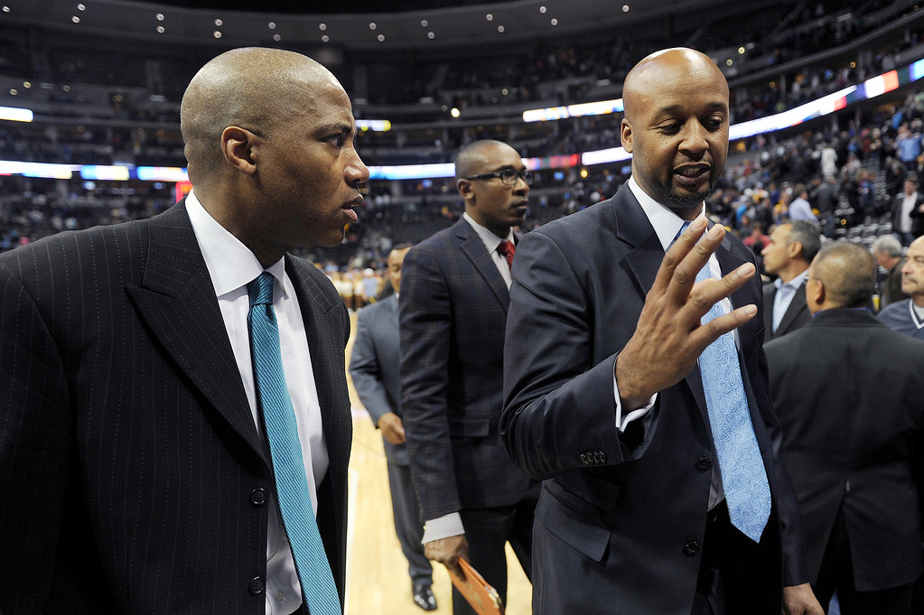 . Denver Nuggets coach Brian Shaw, right, speaks with Denver Nuggets assistant coach Lester Conner, left, after the Denver Nuggets lost to the San Antonio Spurs 102-94 at the Pepsi Center on November 5, 2013, in Denver, Colorado. (Photo by Daniel Petty/The Denver Post)