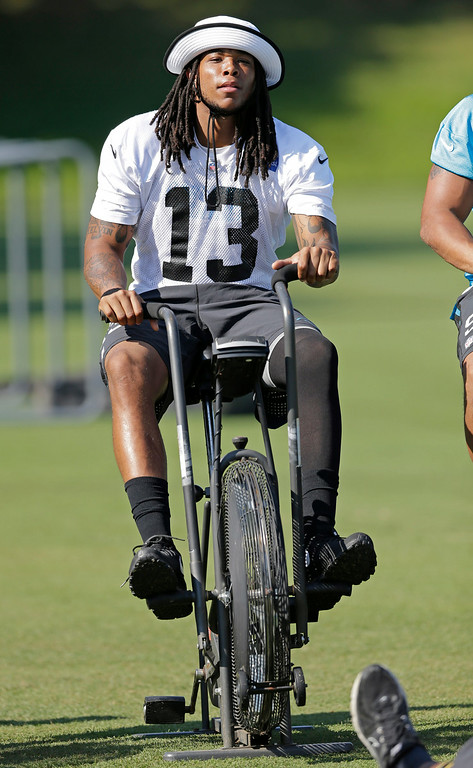 . Carolina Panthers\' Kelvin Benjamin (13) rides a stationary bicycle during an NFL football practice at their training camp in Spartanburg, S.C., Tuesday, July 29, 2014. (AP Photo/Chuck Burton)
