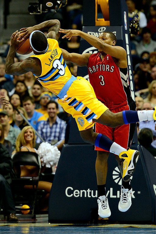 . Denver Nuggets point guard Ty Lawson (3) is fouled by Toronto Raptors point guard Kyle Lowry (3) during the second half of the Nuggets\' 113-110 win at the Pepsi Center on Monday, December 3, 2012. AAron Ontiveroz, The Denver Post