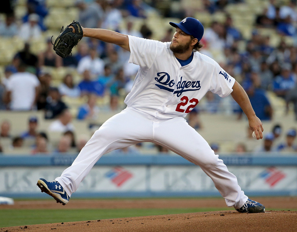 . Los Angeles Dodgers starting pitcher Clayton Kershaw throws against the Colorado Rockies during first inning of a baseball game in Los Angeles, Wednesday, June 18, 2014. (AP Photo/Chris Carlson)