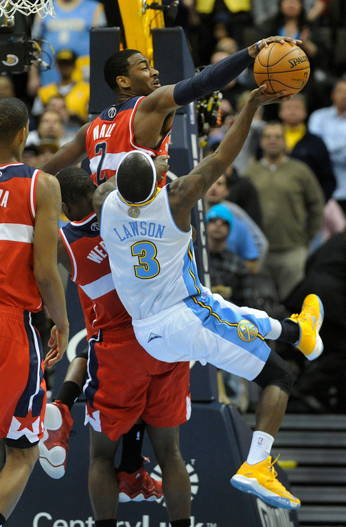 . DENVER, CO - JANUARY 18: Washington guard John Wall (2) rejected a shot from Denver guard Ty Lawson in the final seconds of the the second half. The Washington Wizards defeated the Denver Nuggets 112-108 at the Pepsi Center Friday night, January 18, 2013. Karl Gehring/The Denver Post