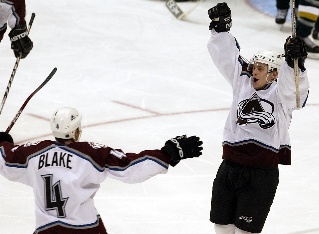 . Avalanche #3 Rob Blake and #40 Marek Svatos celebrate Svatos\' game winning goal during the fifth period of the Dallas Stars vs Colorado Avalanche First Round Hockey Playoff game four at the American Airlines Center in Dallas on Wednesday April 14, 2004. (Star-Telegram/ Sharon M. Steinman)