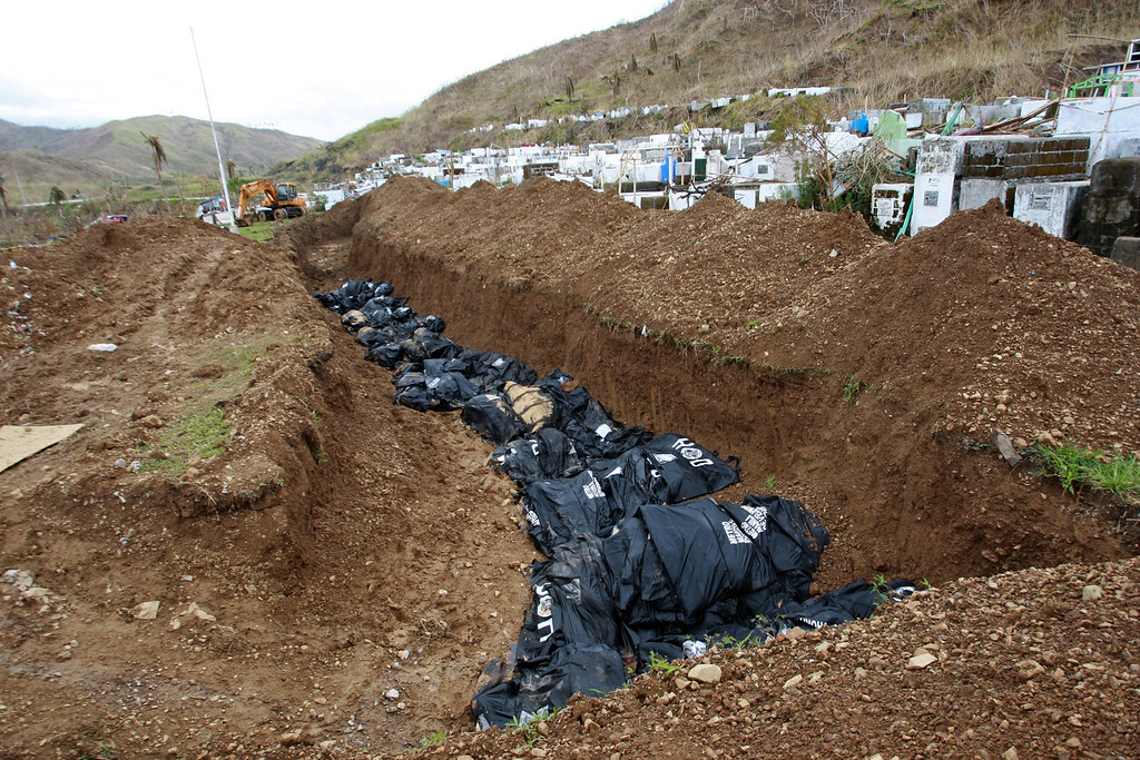 . A mass grave for the dead is seen following the recent typhoon in Tacloban on November 15, 2013 in Tacloban, Philippines. T  (Jeoffrey Maitem/Getty Images)