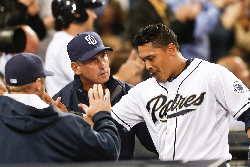 . San Diego Padres\' Everth Cabrera, right, gets the good word from San Diego Padres manager Bud Black after scoring against the Colorado Rockies in the fifth inning of a baseball game Wednesday, April 16, 2014, in San Diego.  (AP Photo/Lenny Ignelzi)