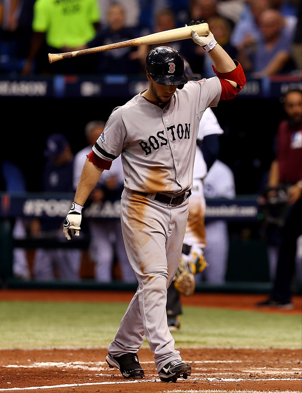 . Daniel Nava #29 of the Boston Red Sox reacts after striking out in the sixth inning against the Tampa Bay Rays during Game Four of the American League Division Series at Tropicana Field on October 8, 2013 in St Petersburg, Florida.  (Photo by Mike Ehrmann/Getty Images)
