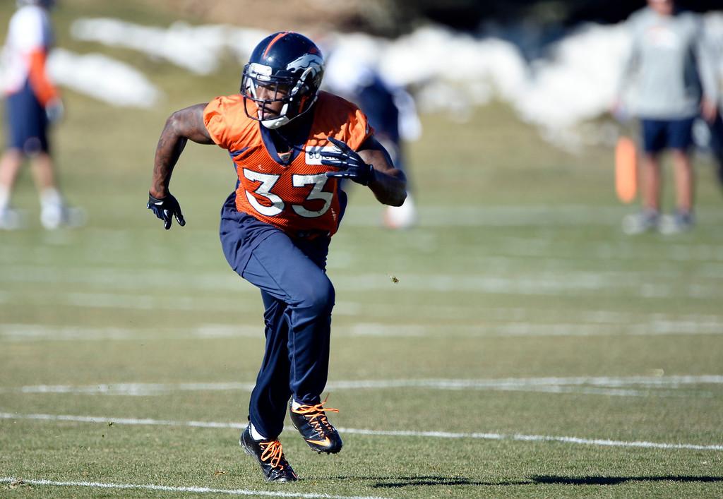 . Denver Broncos strong safety Duke Ihenacho (33) works on drills during practice November 27, 2013 at Dove Valley (Photo by John Leyba/The Denver Post)