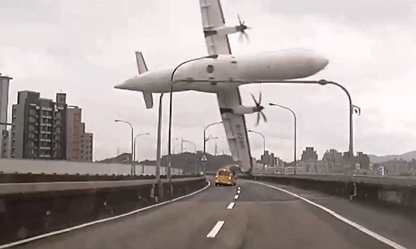 PHOTOS: Taiwan plane crashes into river after clipping bridge