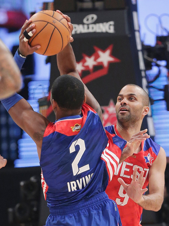 . West Team\'s Tony Parker from France, of the San Antonio Spurs defends East Team\'s Kyrie Irving of the Cleveland Cavaliers during the first half of the NBA All-Star basketball game Sunday, Feb. 17, 2013, in Houston. (AP Photo/Eric Gay)