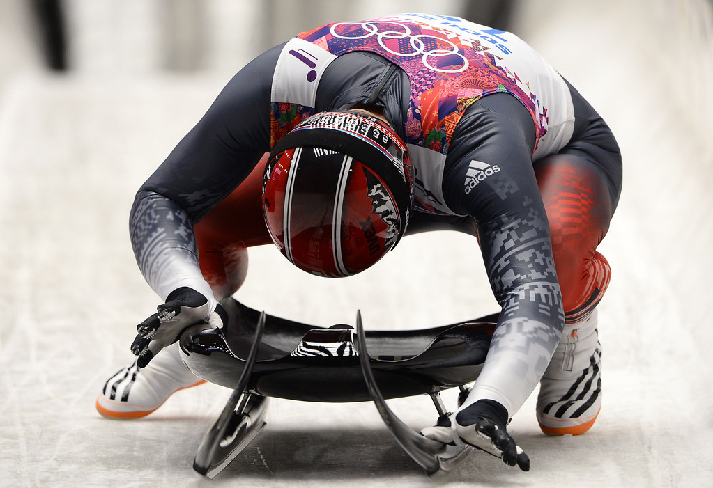 . Switzerland\'s Gregory Carigiet competes during the Men\'s Luge Singles Run at the Sliding Center Sanki during the Sochi Winter Olympics on February 9, 2014.         LIONEL BONAVENTURE/AFP/Getty Images