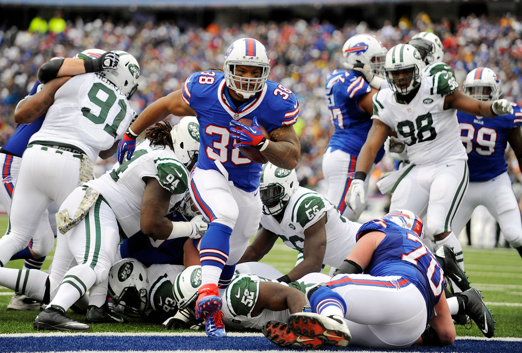 . Buffalo Bills fullback Frank Summers (38) scores a touchdown against the New York Jets during the first half of an NFL football game on Sunday, Nov. 17, 2013, in Orchard Park, N.Y. (AP Photo/Gary Wiepert)
