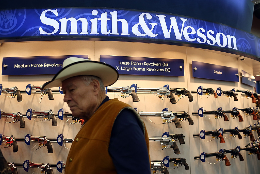 . HOUSTON, TX - MAY 03:  An attendee walks through the Smith and Wesson booth during the 2013 NRA Annual Meeting and Exhibits at the George R. Brown Convention Center on May 3, 2013 in Houston, Texas.  More than 70,000 peope are expected to attend the NRA\'s 3-day annual meeting that features nearly 550 exhibitors, gun trade show and a political rally. The Show runs from May 3-5.  (Photo by Justin Sullivan/Getty Images)