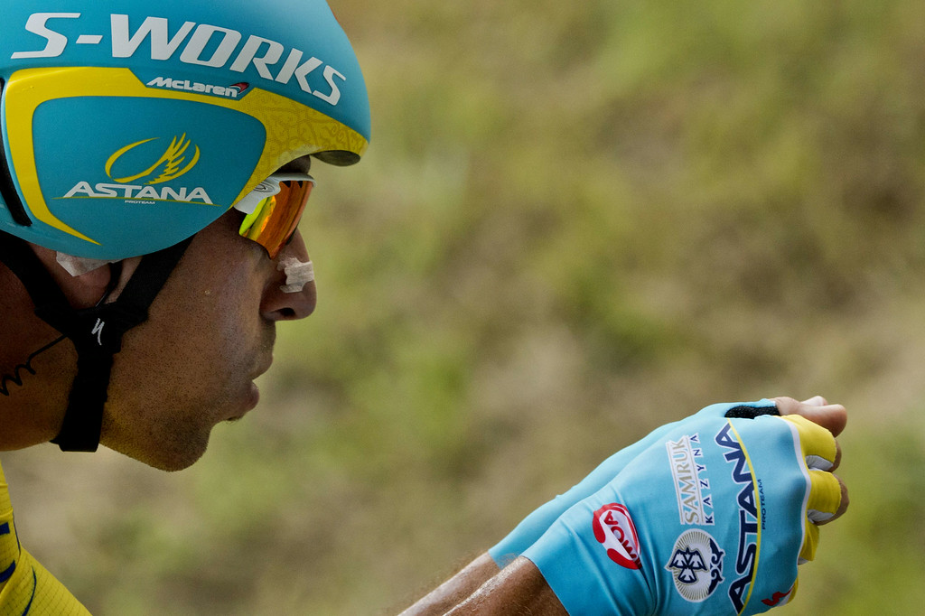 . Italy\'s Vincenzo Nibali wearing the overall leader\'s yellow jersey rides during the twentieth stage, a 54 km individual time trial, as part of the 101st edition of the Tour de France cycling race on July 26, 2014 between Bergerac and Perigueux, western France.  AFP PHOTO / LIONEL  BONAVENTURE/AFP/Getty Images