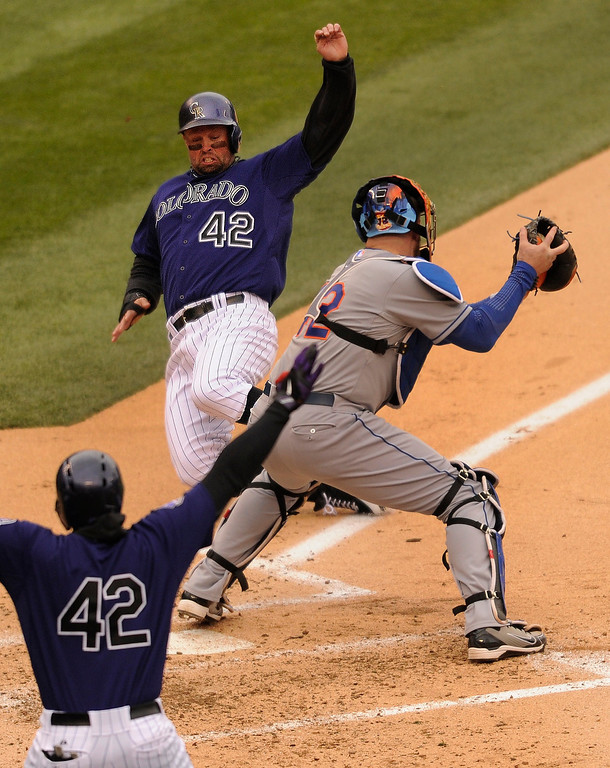 . Rockies baserunner Michael Cuddyer got his foot across the plate before Mets catcher John Buck could apply the tag in the second inning. The Colorado Rockies hosted the New York Mets in a make up game Tuesday afternoon, April 16, 2013. Monday night\'s game was snowed out at Coors Field.  Photo By Karl Gehring/The Denver Post)