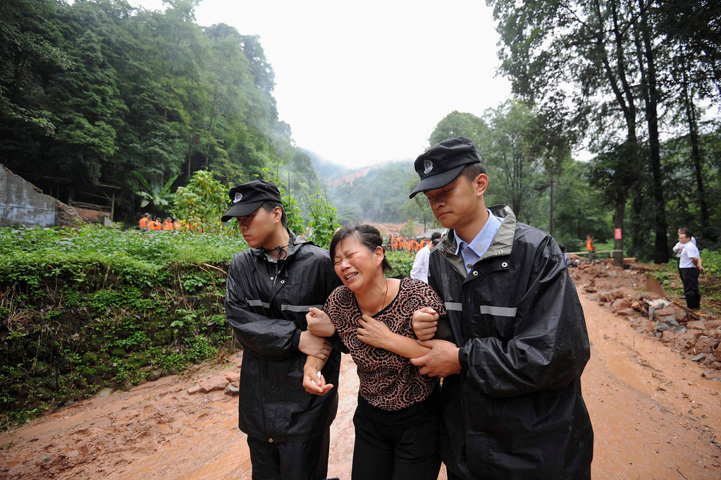 . A family member of a victim killed during a landslide cries, in Dujiangyan, Sichuan Province, July 12, 2013. China braced on Friday for the impact of Typhoon Soulik as the toll of dead and missing from torrential rain across a broad swathe of China climbed beyond 200. Picture taken July 12, 2013. REUTERS/Stringer