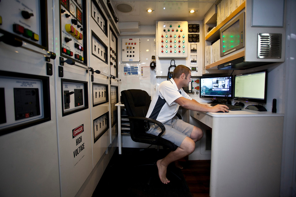 . A crew member uses a computer in a control room onboard the 190ft (57.9m) motor yacht Mi Sueno, manufactured by Trinity Yachts LLC, as it sits moored in the harbor in Nice, France, on Wednesday, Sept. 25, 2013.  Photographer: Balint Porneczi/Bloomberg