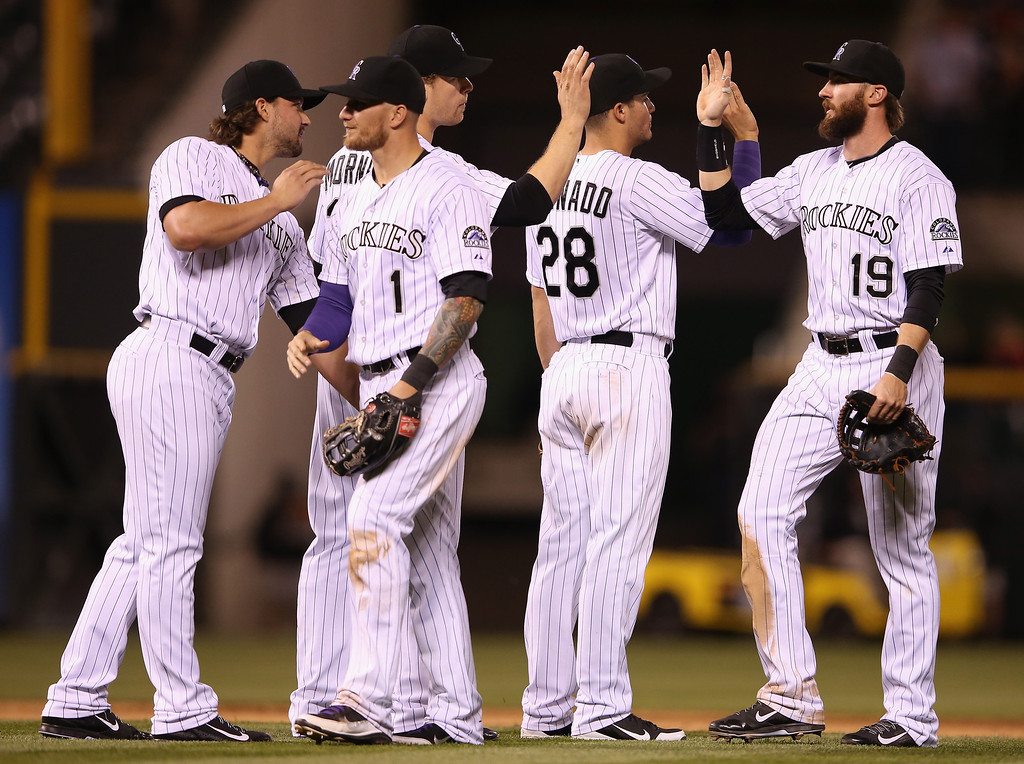 . DENVER, CO - MAY 02:  Tommy Kahnle #54, Brandon Barnes #1, Justin Morneau #33, Nolan Arenado #28 and Charlie Blackmon #19 of the Colorado Rockies celebrtate their 10-3 victory over the New York Mets at Coors Field on May 2, 2014 in Denver, Colorado.  (Photo by Doug Pensinger/Getty Images)